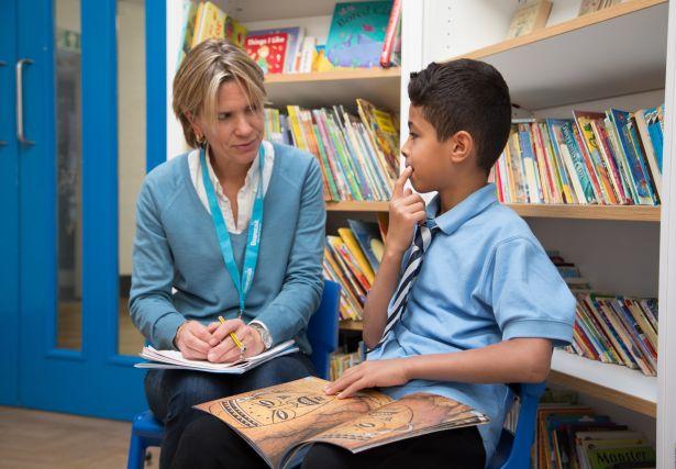 Boy.with.female.reading.helper